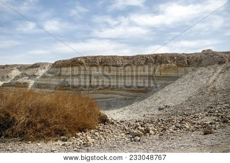 White Chalk Mountains With Multi-colored Strips Of Geological Deposits In The Desert Of Yehuda. The