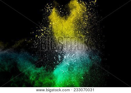 Abstract White Powder Splatter On Black Background,freeze Motion Of Color Powder Explosion. Splash O
