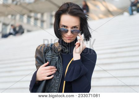 Sensual Woman In Sunglasses On Stairs In Paris, France, Beauty. Woman With Brunette Hair In Black Cl