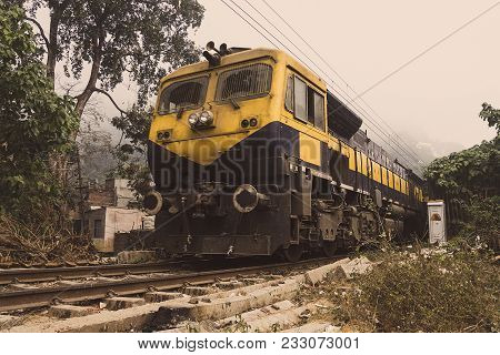 The Yellow Train Goes By Rail In The Desert. Indian Train-the Local Train. Indian Province, Village