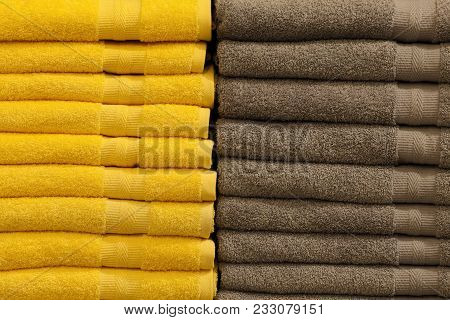 Stack Of Colorful Terry Towels Folded. Shop Home. Two Stacks Of Yellow And Brown Towels Stacked And