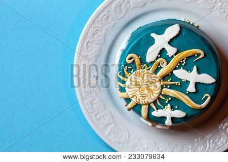 Small Easter Blue Cake With Yellow Sun And White Doves In The White Plate On A Blue Background. A Ca