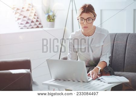 Professional Businesswoman. Attractive Nice Hard Working Businesswoman Sitting In Front Of The Lapto