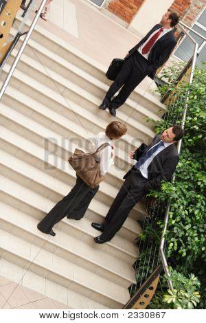 Business Team On Stairway,Leaving Building