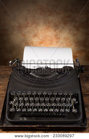 Dusty old antique typewriter with Secretary Day typed on a page