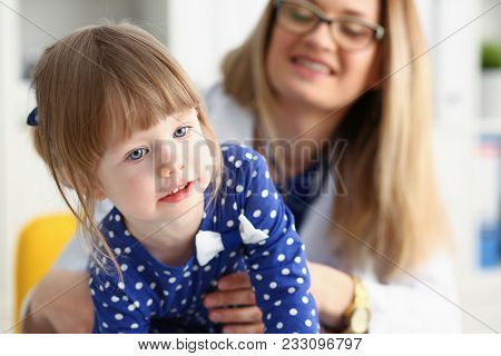 A Small Child Is Afraid In The Hospital Room. The Doctor Holds His Hands And Soothes The Baby Portra