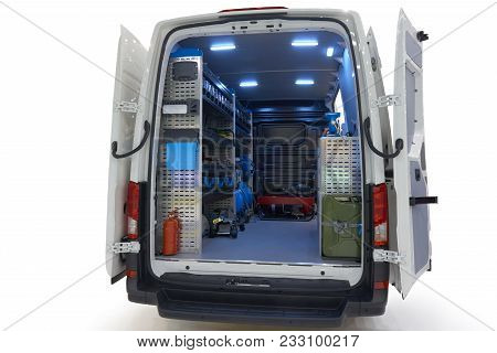 Back view of mobile auto service on the chassis of all-metal van isolated on white poster