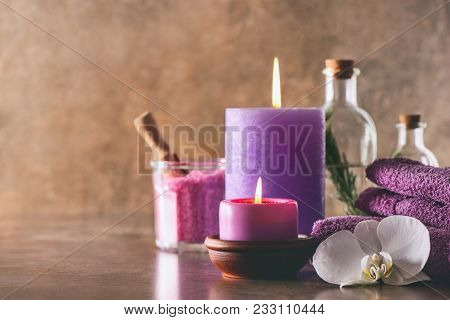 Natural Spa Cosmetic Products Arranged In A Composition With Birning Candles, Front View, Space For
