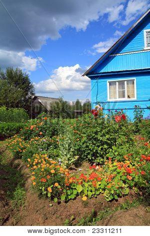 summer flowerses near rural building