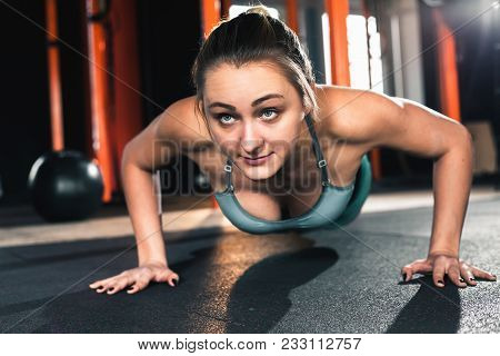 Active People Sport Workout Concept. Attractive Woman Do Push Ups Exercises. Workout Exercise At Gym