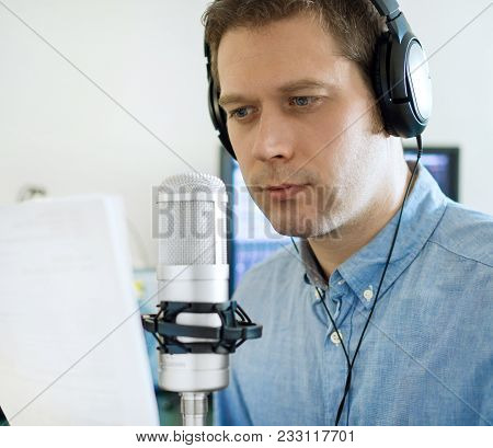 Handsome Man Recording An Advertisement On The Radio Station.