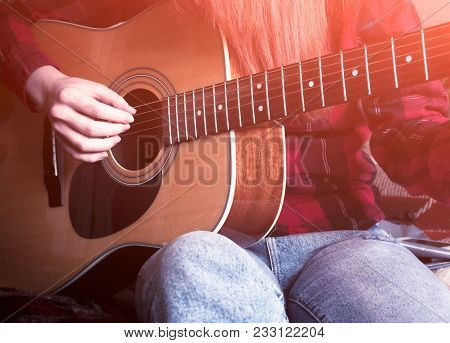 Young Girl Playing The Guitar. Close-up. Vintage