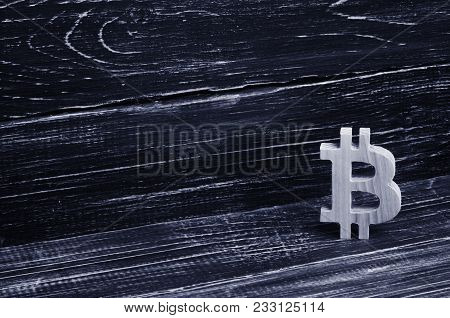 Wooden Bitcoin On A Background Of Black Boards. Crypto Currency, Blocking Technology. The Collapse A