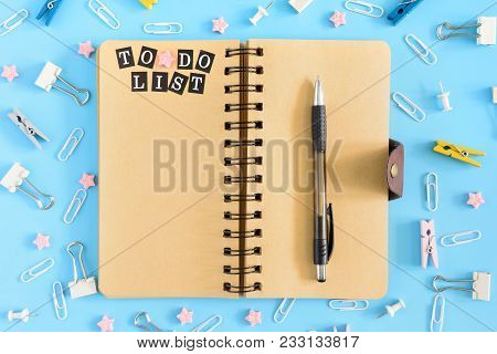 Open Notebook On Springs With An Inscription To Do List. Stationery Razrosannye On A Blue Background