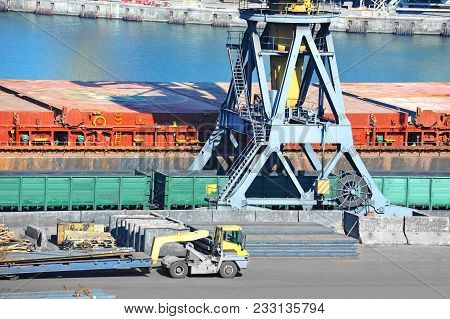 Bulk Cargo Ship And Train Under Port Crane
