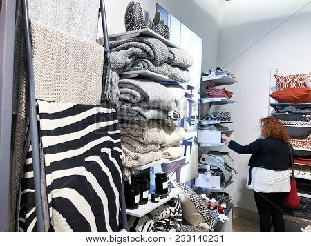 Rishon Le Zion, Israel- December 17, 2017: A Woman Chooses Something Inside The Store At Azrieli Dep