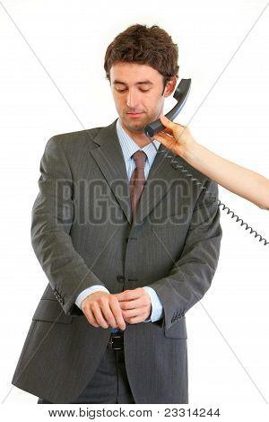 Boss Straightens Cuffs While Secretary Holding Phone