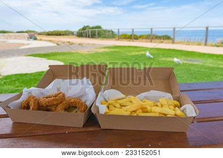 Take Away, Take Out Fish And Chips On Picnic Table. Outdoor Fastfood. Australia