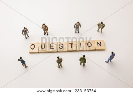 Miniature Figures Businessman : Meeting On Question Letters By Wooden Block Word On White Paper Back