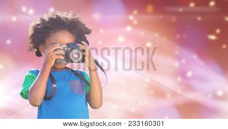 Digital composite of Child photographing over blue background