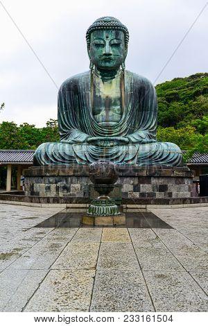 Kamakura, Japan - July 24, 2013: Beautiful And Famous Giant Bronze Buddha Statues Kamakura Daibutsu