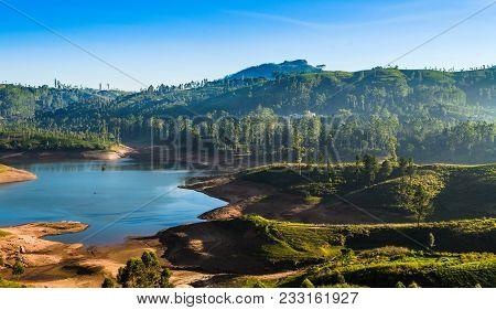 Castlereigh Reservoir And Surrounded Tea Plantations In Sri Lanka