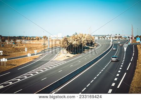 Miltilane Highway Through France With A Toll Payment Point. Top Aerial View