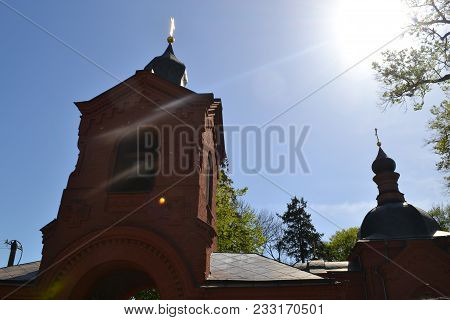 Old Building Of The Church With A Brick With Crosses And The Spire On The Building On A Background O