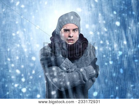 Handsome young boy shivering and trembling at snowstorm concept