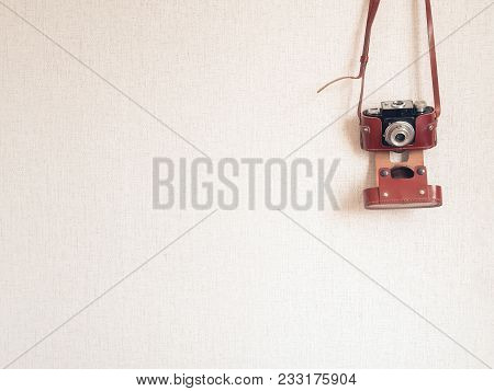 Vintage Rangefinder Photo Camera Hanging On Wall