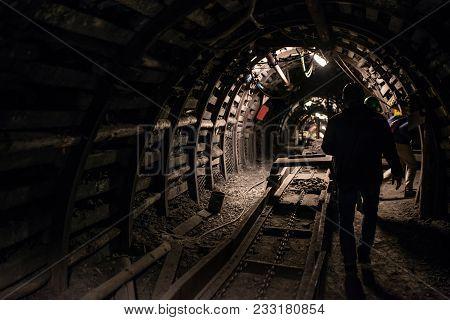 Underground Black Coal Mine With Rail Tracks
