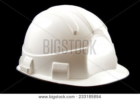 White Protection Helmet Isolated On A Black Background