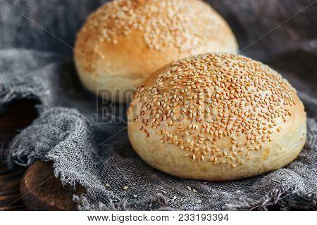 Round Bun, Sesame Bun, Bread Rolls. Tasty Burger Bread With Sesame On Wooden, Burlap Background. Fre