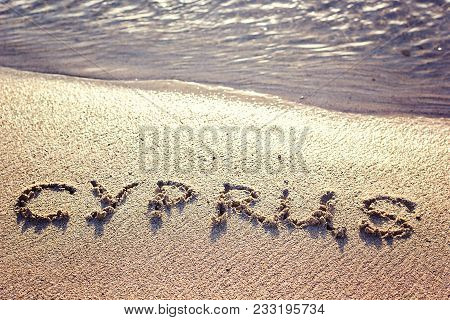 Cyprus Written On Sandy Beach. Name Country Text Card Banner Script. Cyprus Beach The Word Cyprus Wr