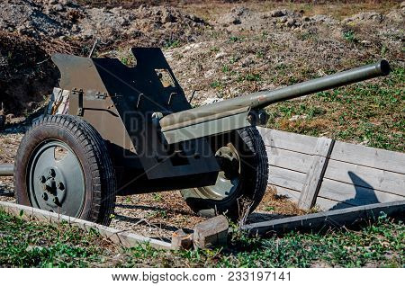 Vintage Machine Gun In A Trench. Old Soviet Machinegun On Position. Old Cannon From World War 2. Old