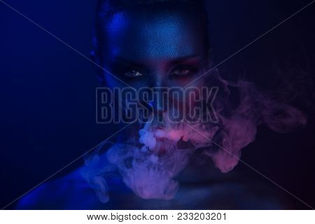 Halloween Night. Horror Vape Party. Beautiful Sexy Young Vamp Woman With Glamorous Mystical Makeup V