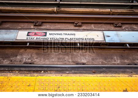 Subway Track Warning. Symbol And Message Warning Commuters To Stay Away From Platform Edge.