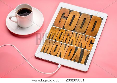 Good Morning Monday word abstract - text in vintage letterpress wood type printing blocks on a digital tablet with a cup of coffee