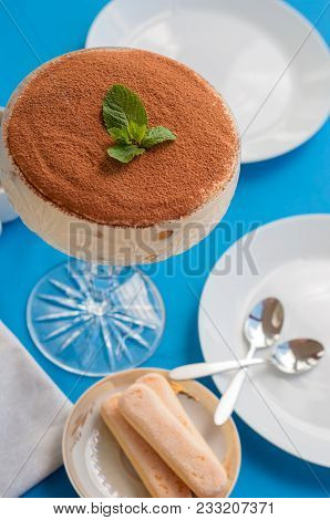 Tiramisu In The Glass Bowl On The Blue Background