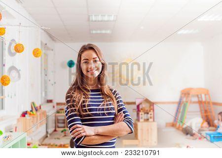 Smiling Young Preschool Teacher In A Waldorf Kindergarten