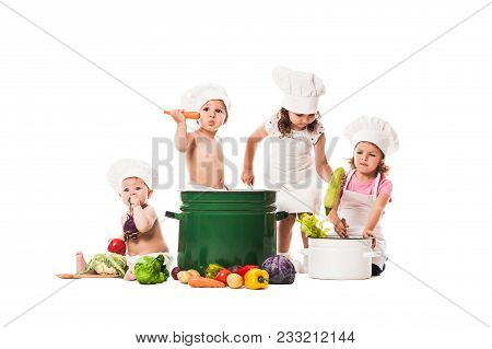 Group Of Kids Play And Cook With Vegetables. Little Chefs Isolated On White, Healthy Eating Concept