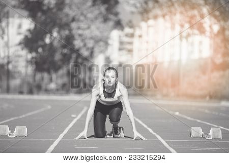 Female Sprinter Getting Ready To Start The Race.