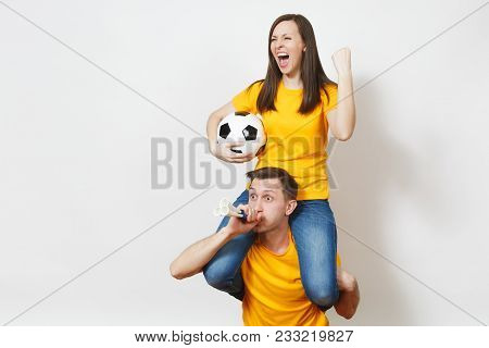 Inspired Young Couple, Woman Sit On Man Shoulders, Fans With Soccer Ball Pipe Cheer Favorite Footbal