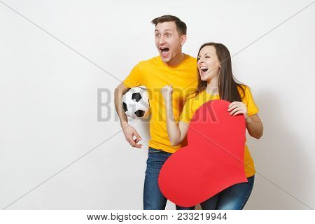 Inspired Young Couple, Woman, Man, Fans With Soccer Ball, Big Red Heart Cheer Favorite Football Team