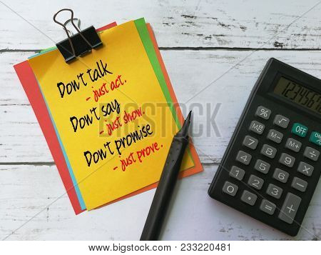 Quotes on act, show and prove, written on sticky note
