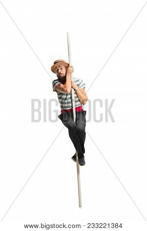Caucasian Funny Bearded Man In Traditional Gondolier Costume And Hat Hanging On Paddle At Studio Iso