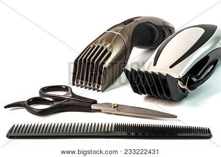 The Machine For A Hairstyle And Hair Trimmer. Hair Clippers And Hair Trimmer Isolated On White Backg