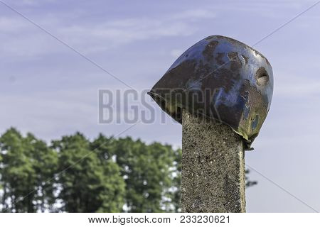 An Old, Leaky Metal Pan, Put On A Concrete Pillar In The Farmyard. The End Of The Summer . Podlasie,