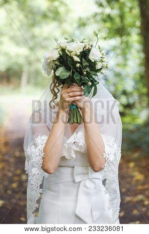 Girl Or Bride With A Head-bouquet Of Roses.bouquet Of Roses Instead Of Head. Bride Hiding Behind A B