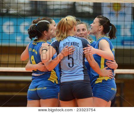 KAPOSVAR, HUNGARY - APRIL 24: Kaposvar players celebrate at the Hungarian NB I. League woman volleyball game Kaposvar (blue) vs Ujbuda (black), April 24, 2011 in Kaposvar, Hungary.